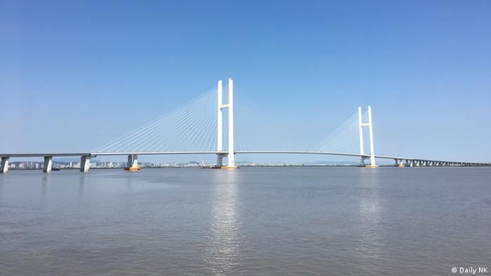 Despite all the restrictions, a viable connection to China is vital for North Korea. A new bridge over the Yalu river, which divides the two countries, is supposed to replace the derelict Sino-Korean Friendship Bridge that covers 70 percent of all bilateral trade. Construction on the North Korean side has stopped due to lack of finance in spite of Chinese private investments.