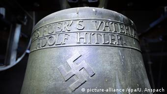 The bell is engraved with a Nazi slogan and a swastika