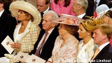 FILE PHOTO: Maria del Carmen and Jorge Zorreguieta (L) sit next to Dutch Queen Beatrix (M) and Crown Prince Willem Alexander (2nd R) and Princess Maxima (R) during the christening ceremony of their granddaughter Catharina-Amalia in the Grote of St Jacobskerk in The Hague June 12, 2004. REUTERS/Pool/Lex van Lieshout/File Photo