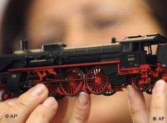 A Maerklin employee examines a toy train