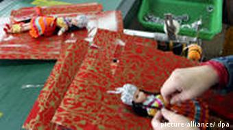 Female Chinese factory workers make dolls at a toy factory in Nanhai