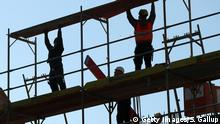 BERLIN, GERMANY - FEBRUARY 27: Workers set up scaffolding at the construction site of a new apartment building on February 27, 2017 in Berlin, Germany. Analysts are warning that the real estate market in Germany is becoming overheated, with houses and apartments now priced on average 10 percent too high. The market has been fueled for years by low interest rates. (Photo by Sean Gallup/Getty Images)