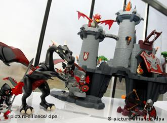 A playmobil castle and dragon play set