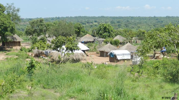 Scene showing a group of huts at Ugandas Rhino refugee camp DWD Pelz
