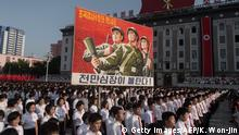 People wave banners and shout slogans as they attend a rally in support of North Korea's stance against the US, on Kim Il-Sung square in Pyongyang on August 9, 2017. US President Donald Trump said the United States' nuclear arsenal was more powerful than ever in a fresh warning to North Korea over its repeated missile tests. / AFP PHOTO / KIM Won-Jin (Photo credit should read KIM WON-JIN/AFP/Getty Images)