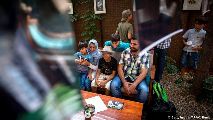Farhad Nouri sits with his family in Belgrade
