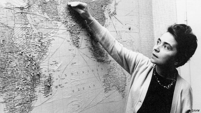 Dr. Ruth Pfau stands before a map of the world