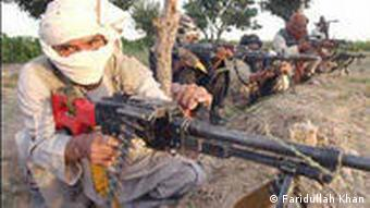 Taliban fighters with machine guns