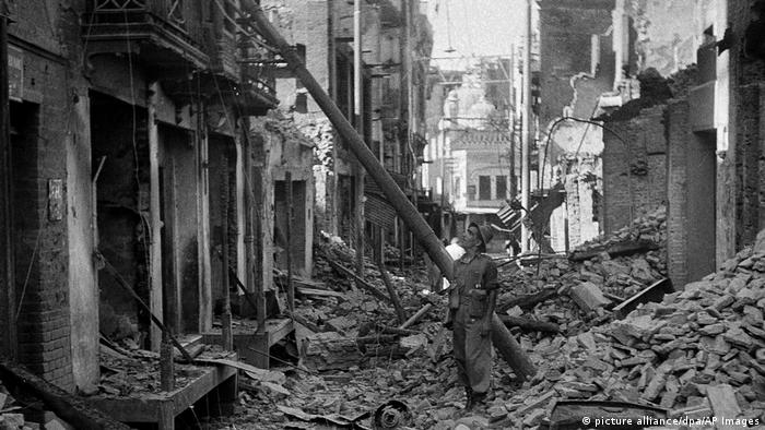 Destruction in a shopping street in Lahore