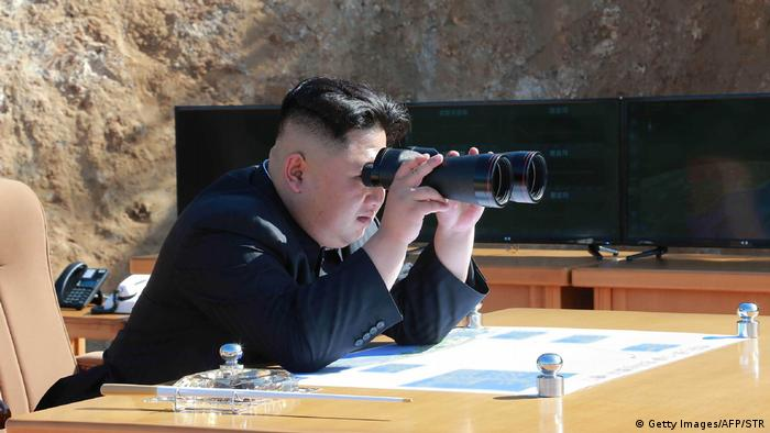 North Korea's Kim Jong Un watching a missile test