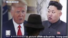 Seoul Donald Trump und Kim Jong Un auf einem Screen