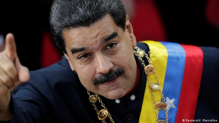 Venezuelan President Nicolas Maduro points as he arrives to the Constituent Assembly session