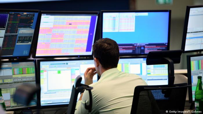 A trader sits at his desk at the Frankfurt Stock Exchange.