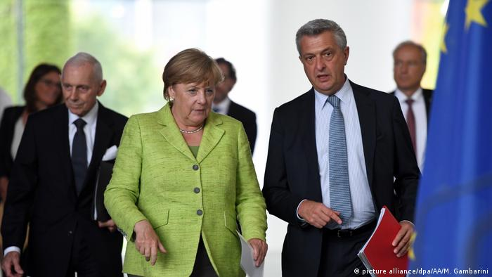 Deutschland Berlin - Angela Merkel, Filippo Grandi und William Lacy Swing (picture alliance/dpa/AA/M. Gambarini)
