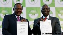 Incumbent President Uhuru Kenyatta and Deputy President William Ruto hold their certificates after Kenyatta was announced winner of the presidential election at the IEBC National Tallying centre at the Bomas of Kenya, in Nairobi, Kenya August 11, 2017. REUTERS/Thomas Mukoya