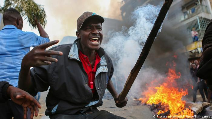 Protester in front of fire in Kenya