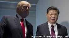 US President Donald Trump and Chinese President Xi Jinping, right, arrive for a meeting on the sidelines of the G-20 Summit in Hamburg, Germany, Saturday, July 8, 2017. (Saul Loeb/Pool Photo via AP) |