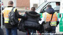 Police officers accompany a failed asylum-seeker to Leipzig-Halle Airport in Schkeuditz