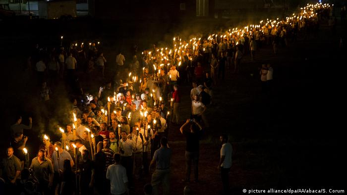 Hundreds of torch-bearing white nationalists rally in Virginia
