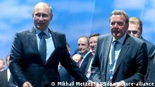 VLADIVOSTOK, RUSSIA. SEPTEMBER 4, 2015. Russia's President Vladimir Putin and Germany's Former Chancellor Gerhard Schroder (L-R front) attend the opening ceremony of the 2015 Eastern Economic Forum on Russky Island. Mikhail Metzel/TASS |
