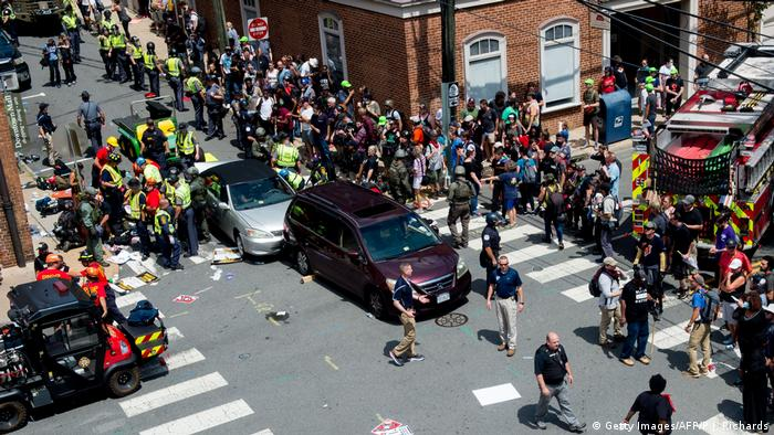 People receive first-aid after a car rammed into counter-protesters at a rally in Charlottesville, Virginia (Getty Images/AFP/P.J. Richards)