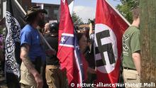Demonstrators carry confederate and Nazi flags