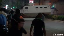 An armoured vehicle opens fire in the direction of a restaurant following an attack by gunmen on the restaurant in Ouagadougou, Burkina Faso, in this still frame taken from video August 13, 2017. REUTERS/Reuters TV