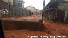 FREETOWN, Aug. 14, 2017 This image taken on Aug. 14, 2017 shows mud and water flow in Freetown, Sierra Leone. Mudslides after heavy rains and flooding killed more than 200 people in Sierra Leone. gl |