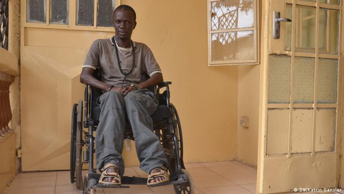 Yusufa Mbaye on a wheelchair in his house