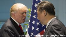US President Donald Trump and Chinese President Xi Jinping, right, shake hands prior to a meeting on the sidelines of the G-20 Summit in Hamburg, Germany, Saturday, July 8, 2017. (Saul Loeb/Pool Photo via AP)  