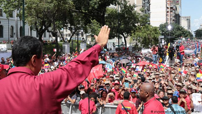 Nicolas Maduro waves to a crowd in Caracas