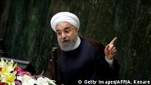 Iranian President Hassan Rouhani addresses a parliamentary session in Tehran on August 15, 2017. Rouhani warned that Iran could abandon its 2015 nuclear deal with world powers within hours if the United States keeps on imposing new sanctions as he outlined plans for his new term.