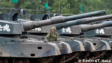 A member of Japan Ground Self Defense Force stands on a type 90 tank during a joint exercise with U.S. Marine Corps, named Northern Viper 17, at Hokudaien exercise area in Eniwa, on the northern island of Hokkaido, Japan, August 14, 2017. REUTERS/Toru Hanai TPX IMAGES OF THE DAY