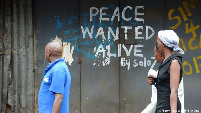 Graffiti on a wall saying 'Peace wanted alive (Getty Images/AFP/S. Maina)