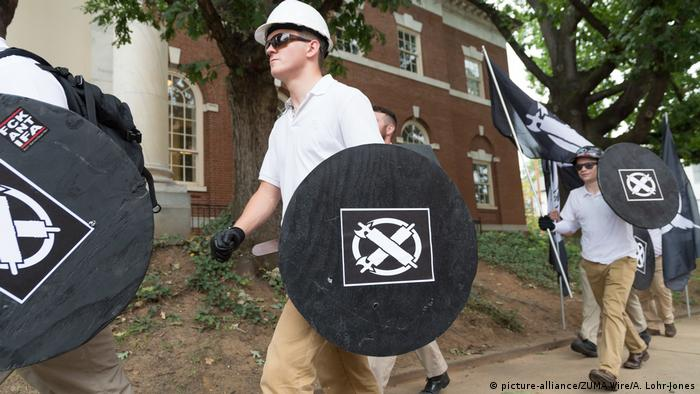 Members of the Unite the Right rally carrying shields