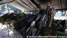 FILE - In this Feb. 28, 2017 file photo, weapons belonging to rebels of the Revolutionary Armed Forces of Colombia, FARC, are stored at a rebel camp in La Carmelita near Puerto Asis in Colombia's southwestern state of Putumayo. The United Nations began removing containers on Monday, July 31, 2017, holding weapons from demobilization zones where the arms were handed over by former fighters for Colombia's largest rebel group who are beginning life as civilians under a peace agreement. (AP Photo/Fernando Vergara, File) |
