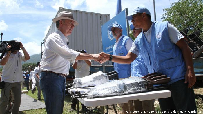 President Santos reviews the handing over of weapons in Colombia