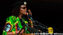 02.06.2017 +++ Zimbabwe first lady Grace Mugabe addresses the crowd during a Zimbabwe ruling party Zimbabwe African National Union Ð Patriotic Front (ZANU-PF) youth rally at Rudhaka Stadium in Marondera on June 2, 2017. Zimbabwean President Robert Mugabe on June 2, 2017 launched a nationwide 10-venue speaking tour aimed at drumming up support ahead of elections next year when he plans to seek office again. The 93-year-old leader, who appeared in better health than at some recent public appearances, spoke for an hour and a half at a rally outside Harare attended by several thousand ZANU-PF supporters. / AFP PHOTO / Jekesai NJIKIZANA (Photo credit should read JEKESAI NJIKIZANA/AFP/Getty Images)