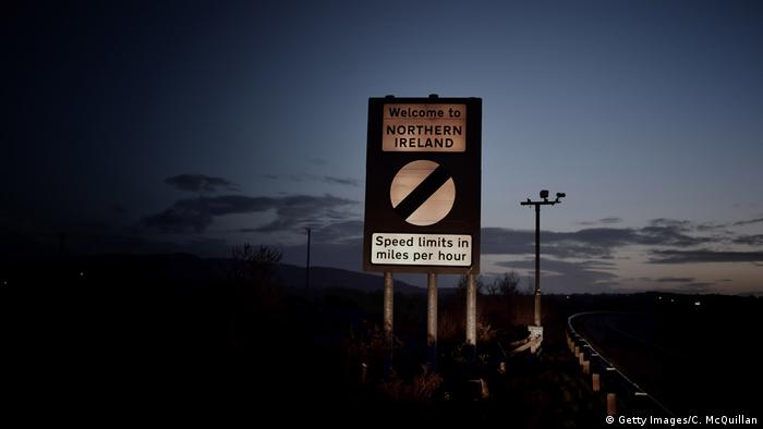 A welcome to Northern Ireland road sign indicating the change from kilometers per hour to miles per hour speed laws is illuminated by car headlights on May 2, 2016 in Northern Ireland (Getty Images/C. McQuillan)