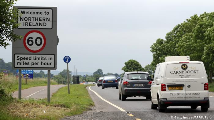 Cars cross a border without customs posts between Ireland and Northern Ireland