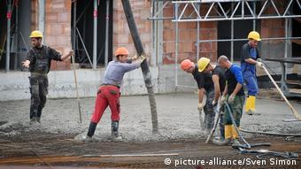 Строители из стран ЕС на стройке в Германии