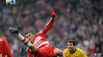 Bayern Munich soccer player Lucio attempts a bicycle kick