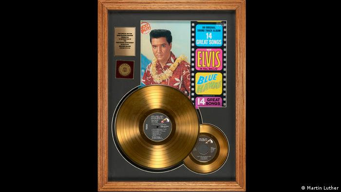 A frame with two gold records and Elvis on the cover in the exhibition Oh Yeah Pop Music in Germany in Frankfurt. (Photo: Martin Luther)