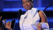 """Jennifer Hudson gets emotional as she accepts the award for best R&B album for """"Jennifer Hudson"""" at the 51st Annual Grammy Awards on Sunday, Feb. 8, 2009, in Los Angeles. (AP Photo/Mark J. Terrill)"""