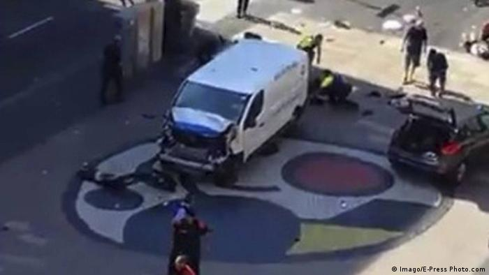 A white van with its front-end smashed stood idle as police surveyed the scene.