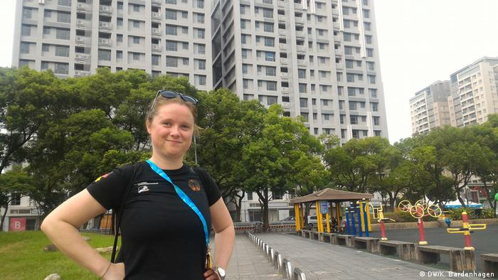 Malin Hoster stands in the athlete village. She wants the German team to stay away from politics while in Taiwan (DW/K. Bardenhagen)