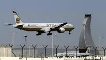 FILE - In this May 4, 2014 file photo, an Etihad Airways plane prepares to land at the Abu Dhabi airport in the United Arab Emirates. A U.S. official tells The Associated Press that the ban beginning Tuesday, March 21, 2017, affects airports in 10 cities of Cairo in Egypt; Amman in Jordan; Kuwait City in Kuwait; Casablanca in Morocco; Doha in Qatar; Riyadh and Jeddah in Saudi Arabia; Istanbul in Turkey; and Abu Dhabi and Dubai in the United Arab Emirates. (AP Photo/Kamran Jebreili, File) |
