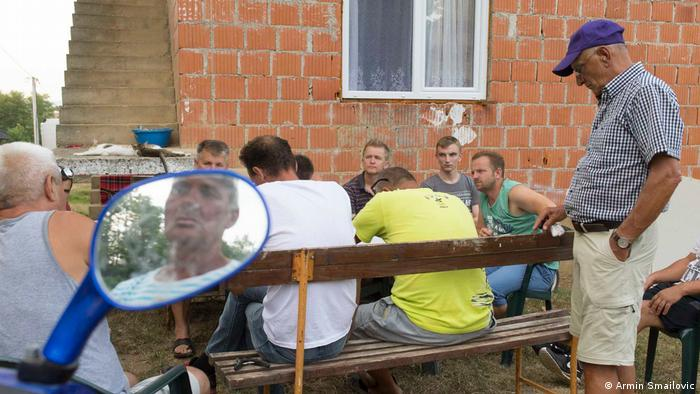 Z.B. discussing protocol around the upcoming memorial with some men from the village