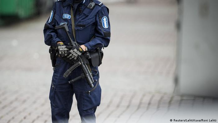 Police stand guard following a knife attack in the Finnish city of Turku