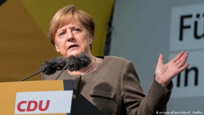 Angela Merkel booed in far-right stronghold